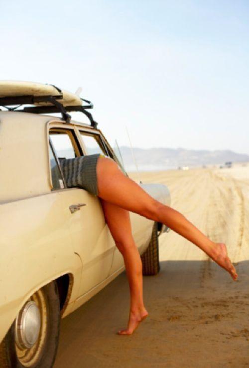 woman's legs outside a car in the dessert