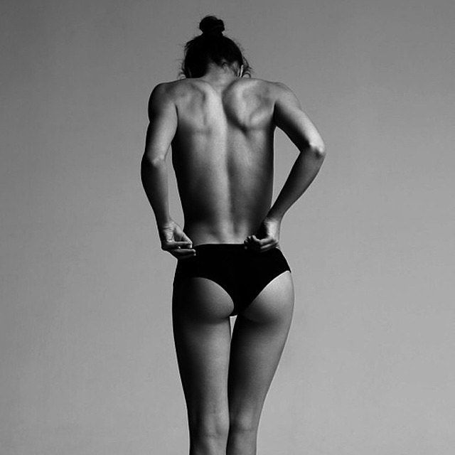 black and white of girl standing with underwear