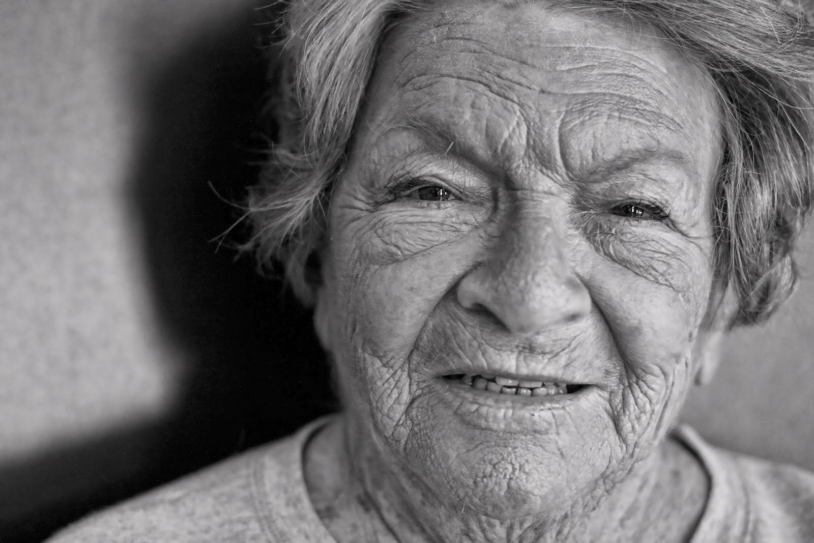 black and white of old wrinkled woman