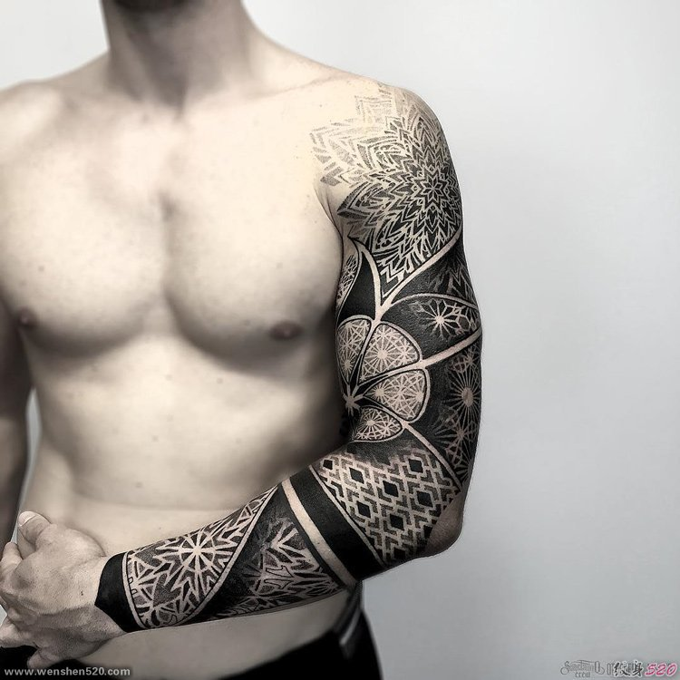guy's chest with arm tattoo